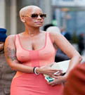 Amber Rose seen wearing body hugging pink skirt in NYC